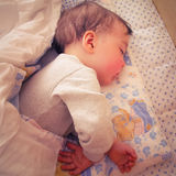 Baby boy. Sleeping in his bed Stock Image