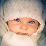 Baby boy. Dressed in cap and scarf at cold day Royalty Free Stock Photos