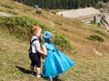 Baby boy and adorable child girl on grass. Summer green nature background. Royalty Free Stock Image