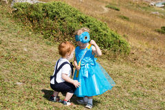 Baby boy and adorable child girl on grass. Summer green nature background Stock Photography