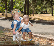 Baby boy and adorable child girl in park. Summer green nature . Stock Photography