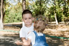 Baby boy and adorable child girl in park. Summer green nature . Stock Image