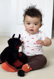 Baby boy. Adorable baby boy indoors posing sitting on the carpet Stock Images