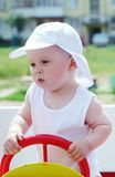 Baby boy age of 9 months on playground outdoors Royalty Free Stock Image