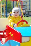 Baby boy age of 8 months on playground Royalty Free Stock Photo