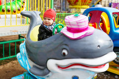 Baby boy in amusement park Stock Photo
