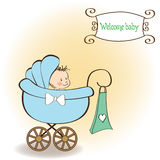 Baby boy announcement card with baby. And pram Stock Photo