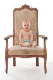 Baby boy on an antique chair Royalty Free Stock Image