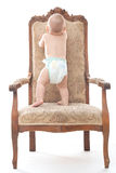 Baby boy on an antique chair Royalty Free Stock Photo