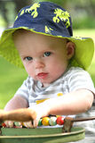 Baby boy in antique stroller outdoors in summer Royalty Free Stock Images