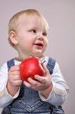 Baby boy with an apple Royalty Free Stock Images