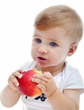 Baby boy with apple Royalty Free Stock Images