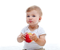 Baby boy with an  apple Royalty Free Stock Image