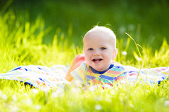 Baby boy with apple on family garden picnic Stock Photo