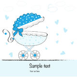 Baby boy arrival card with baby stroller Stock Images