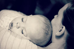 Baby Boy Asleep on Mommys Shoulder Royalty Free Stock Images