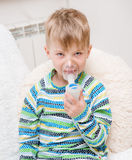 Baby boy with asthma problems making inhalation with mask Royalty Free Stock Photography