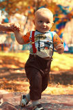 Baby boy in autumn park Royalty Free Stock Photography