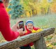 Baby boy in the autumn park Stock Photo