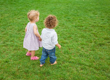 Baby boy and baby girl in the park Stock Images