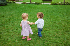 Baby boy and baby girl in the park Royalty Free Stock Photos