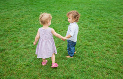 Baby boy and baby girl in the park Royalty Free Stock Images