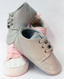 Baby boy and baby girl shoes. Intertwined Royalty Free Stock Photos