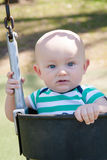 Baby Boy in a Baby Swing Royalty Free Stock Photography