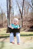 Baby Boy in a Baby Swing Stock Photography