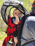 Baby boy in back carrier Royalty Free Stock Images
