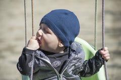 Baby boy. Background, happy baby boy, baby boy swings Stock Photo