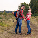 Baby boy in backpack Stock Image