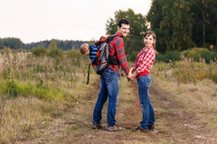 Baby boy in backpack Stock Images