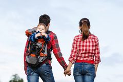 Baby boy in backpack Royalty Free Stock Photos
