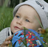 Baby boy with ball. Portrait of cute baby boy with ball outdoors Royalty Free Stock Photo