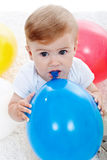 Baby boy and ballons. Baby boy with blue balloon - isolated Royalty Free Stock Photos