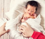 Baby boy being cared for by his mother Stock Photography