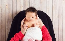 Baby boy being cared for by his mother Royalty Free Stock Photography