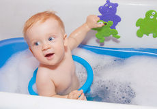 Baby boy in bath Stock Images