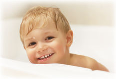 Baby boy bathing Stock Photography