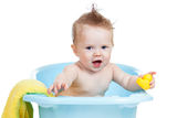 Baby boy bathing. And playing toy royalty free stock images