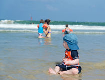 Baby boy at the beach. Cute Baby boy staring at the ocean royalty free stock photography