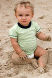 Baby boy on beach sand Stock Photography