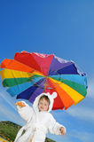 Baby boy on the beach under umbrella, copy space Stock Images