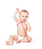 Baby boy with beads; Stock Photo