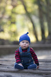 Baby boy with beanie on a glowing Autumn day Royalty Free Stock Image