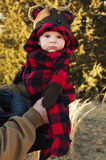 Baby boy with bear hood Stock Images