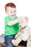 Baby boy with bear toy Royalty Free Stock Photography