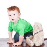 Baby boy with bear toy over white Royalty Free Stock Image