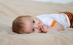Baby boy on bed Stock Image